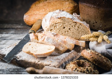 Fresh homemade slice bread and knife on rustic table