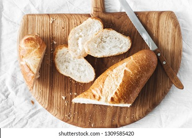 Fresh Homemade Sliced French Baguette Bread On Wooden Bread Board Top View