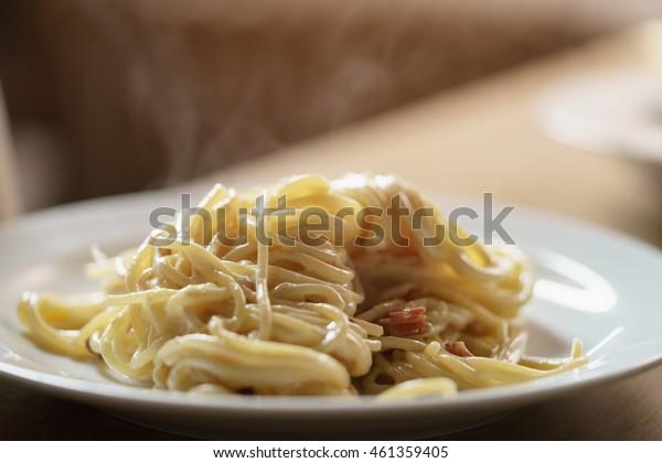 fresh homemade spaghetti carbonara with smoked bacon