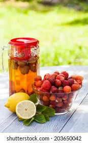 Fresh homemade strawberry lemonade with natural background. Summer.
