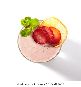 Fresh homemade strawberry yogurt smoothie decorated with strawberry slices and mint. Iced yoghurt shake vitamin detox cocktail with natural eco berries juice isolated on white background topview
