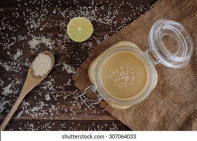 Fresh homemade Tahini (sesame paste) in a glass jar