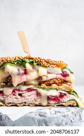 Fresh Homemade Turkey Sandwich with brie cheese, spinach and cranberry sauce