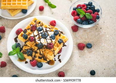 Fresh homemade waffles with blueberries and raspberries