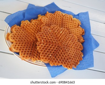 Fresh homemade waffles, on a white wooden table