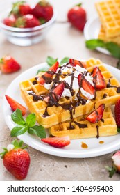 Fresh homemade waffles with strawberries