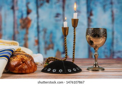 Fresh homemade wine, challah and candles for the Holy Sabbath Prayer Shawl Tallit jewish religious symbol