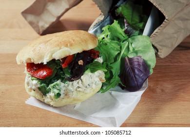 Fresh homestyle chicken Salad Sandwich garnished with leafy lettuces