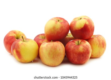 "fresh ""honey crunch"" apples on a white background"
