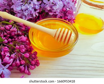 fresh honey flower lilac on a wooden background