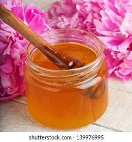 Fresh honey in glass bank . Selective focus.