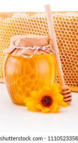Fresh honey with honeycomb isolated on white background