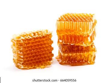 Fresh honeycombs and honey isolate on white background