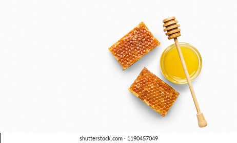 Fresh honeycombs and honey in jar with dipper, isolated on white background, top view, copy space. Natural organic ingredient poster