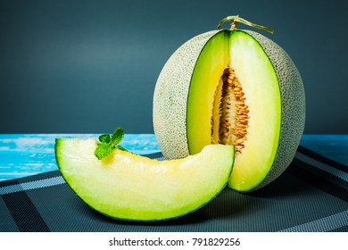 Fresh Honeydew melon on wooden table, healthy food.