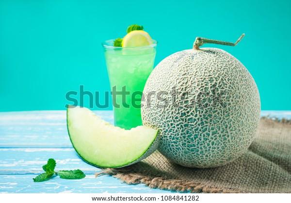Fresh Honeydew melon on wooden table, healthy food.