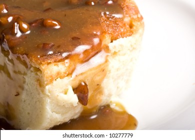 fresh hot bread pudding topped with caramel syrup and pecans