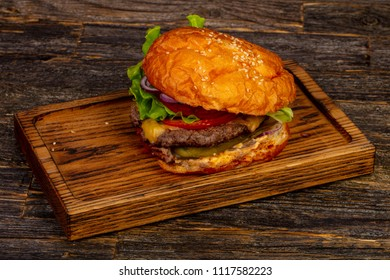Fresh hot burger with beef, cheese and red onion