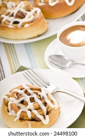 Fresh hot cinnamon rolls straight from the oven with a coffee.
