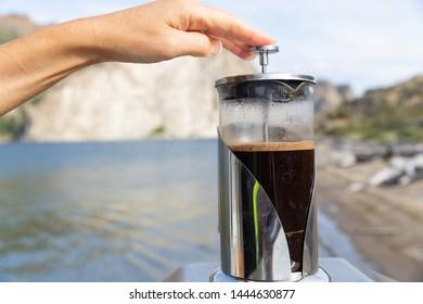 Fresh hot coffee prepared in a French Press
