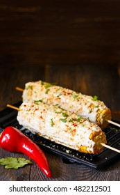 Fresh hot mexican street corn on a grill.