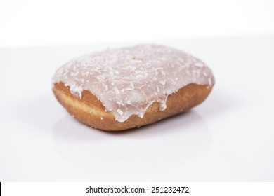 Fresh hot polish donut with jam, coconut and icing isolated on white background