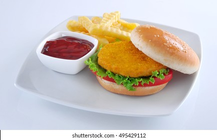 Fresh and hot Potato Burger with fries and tomato sauce.
