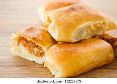 fresh hot Russian pies with cabbage and carrots