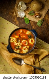 Fresh hot tortellini tomato soup with potatoes mushrooms and cannellini beans