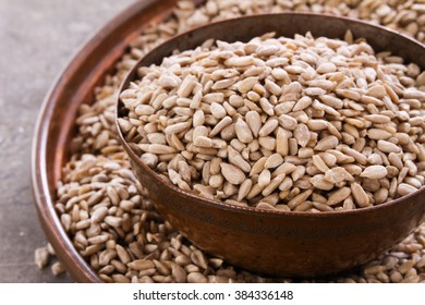 fresh hulled sunflower seeds in copper dish