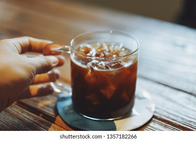 Fresh ice cold brew Caffe Americano on the wooden desk for the brand new good day