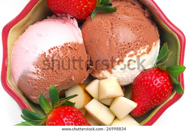 Fresh ice cream served with strawberries and chocolate studio isolated on white background