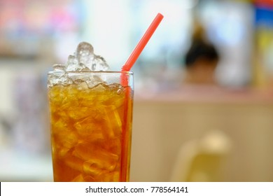Fresh ice tea in glass with blur background.