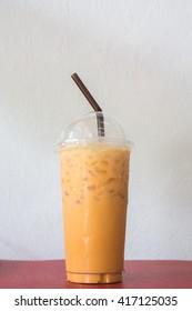 Fresh ice tea in plastic glass on white background
