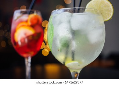 fresh iced fruit drinks on a wooden background, closeup, horizontal
