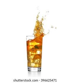 Fresh iced tea splashing in glass