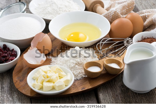 fresh ingredients for baking on a wooden board, horizontal, close-up