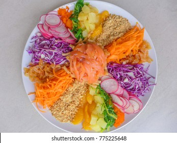 Fresh ingredients consisting of smoked salmon,radish,carrot,mandarin orange,jelly fish,pineapple / Colorful Prosperity Toss aka Lou Sang / Symbols of abundance,prosperity and vigor in chinese's belief