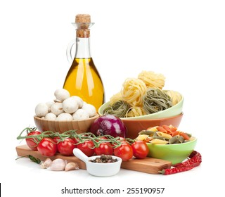 Fresh ingredients for cooking: pasta, tomato, mushroom and spices. Isolated on white background