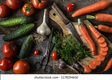 Fresh ingredients for cooking in rustic setting,  tomatoes, carrots  and cucumbers. Natural organic healthy food concept. Top view