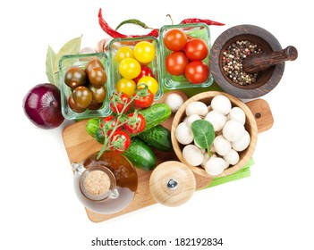 Fresh ingredients for cooking: tomato, cucumber, mushroom and spices. Isolated on white background