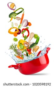 fresh ingredients falling flying into red cooking pot with water splash creative cooking concept isolated on white background