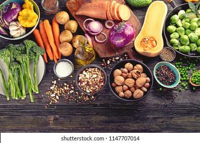 Fresh ingredients for healthy cooking  on rustic wooden background. Vegan, vegetarian  or diet food concept. Top view