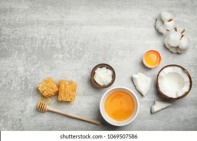Fresh ingredients for homemade effective acne remedies on grey background, flat lay