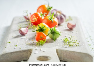 Fresh ingredients for pickled red tomatoes on wooden table