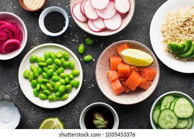 Fresh ingredients for rice edamame salmon poke bowl. Top view