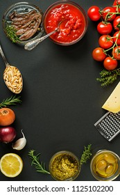 Fresh ingredients and spices on black background. Healthy cooking concept