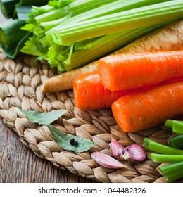 Fresh ingredients for veggie stock : carrots, celery, leeks, onion, carrots, parsnip, parsley, garlic, peppercorns, chili. Spring and summer products for soup seasonal vegetables, best from farm shop.