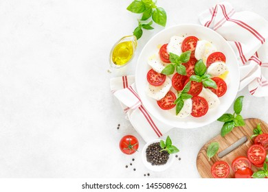 Fresh italian Caprese salad on white plate, view from above