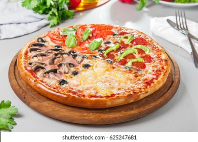 Fresh Italian Four Seasons Pizza (Pizza Quattro Stagioni) On The Wooden  Board On The